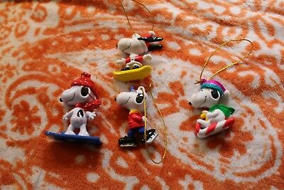 4 Snoopy Christmas ornaments