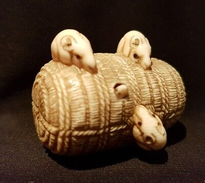 A 19th C meiji period netsuke of mice on a basket. Signed.