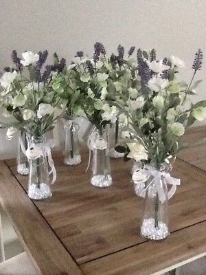 Table Decorations (qty of 7)  flowers in a glass bottle with white beads