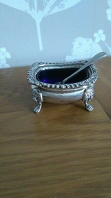 salt dish and silver spoon