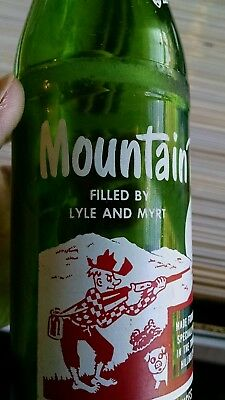 FILLED BY LYLE AND MYRT Vintage MOUNTAIN DEW Bottle Nice Graphics Good Condition