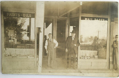 Store Front Shop Window Sign Two Men One Cent Stamp 1917 Old RPPC Photo Postcard