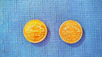 Cocoa Beach Pier Token, value $1.00 trade for food, drink, merchandise, fishing.