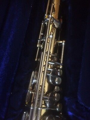 Boosey and Hawkes 400 Tenor Saxaphone with hard case.