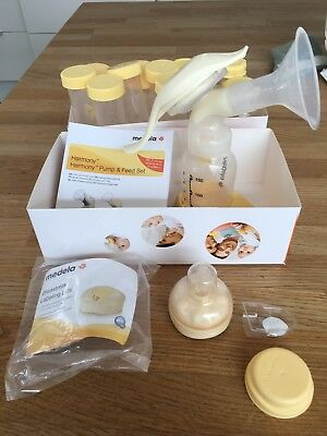 Medela harmony manual breast pump with box,  instructions and lots of extras