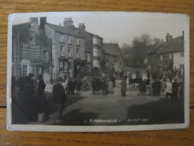 Old 1922 RPPC Busy market day KIRBYMOORSIDE Yorks