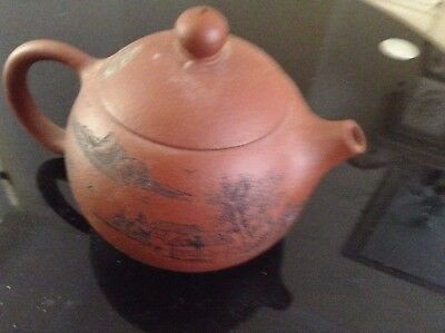 Antique oriental chinese tea pot with different scene all around it