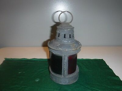 Antique Helvic's Oil Boat Navigation Port Lantern. With badge & red/green glass