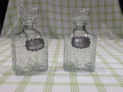 TWO GLASS DECANTERS  with Whisky and Gin Silver labels