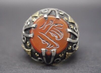 Antique Islamic silver ring with calligraphy insert and gold inlay