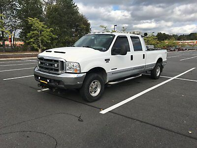 2000 Ford F-250  f250 Diesel 4x4 with 9 1/2' fisher plow