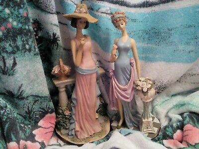 Two fabulous elaborate Art Deco style lady figurines.