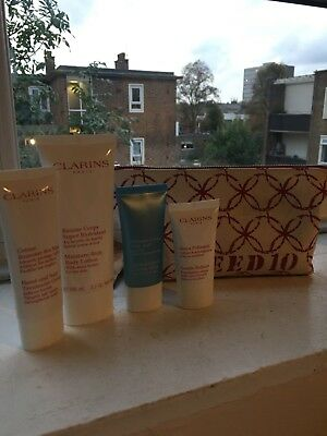 BRAND NEW CLARINS 'feed 10' gift set/travel Set- Body Lotion, Mask, Refiner