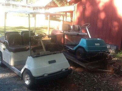 Two G  1 vintage golf carts