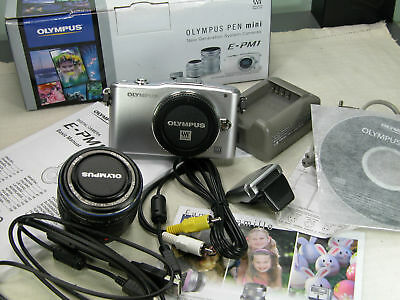 BOXED OLYMPUS PEN E-PM1 Digital 12.3 Mp with M zuiko 14-42mm ED Flash FL-LM1