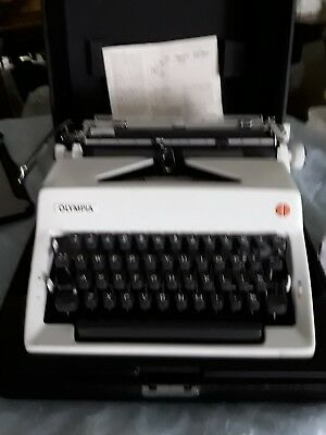 Vintage Olympia SM typewriter with instructions and quality black case