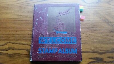 OLD WELCOME STAMP  ALBUM: MIXED LOT OF WORLD STAMPS - 100s of  OLD USED STAMPS.