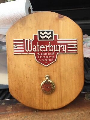 Waterbury Clocks And Watches Advertising Plaque Emblem Sign