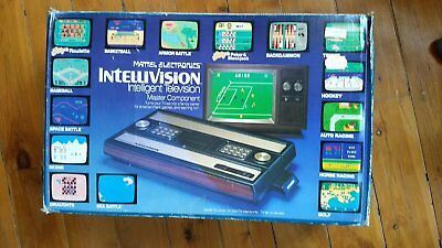 Mattel Intellivision video game console complete with box and 10 games.