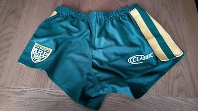 Australian rugby league shorts dark green yellow stripes. Used good condition.