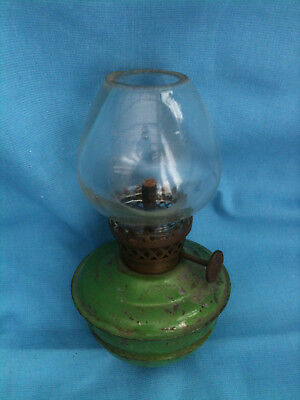 Miniature oil lamp with green metal base and wick