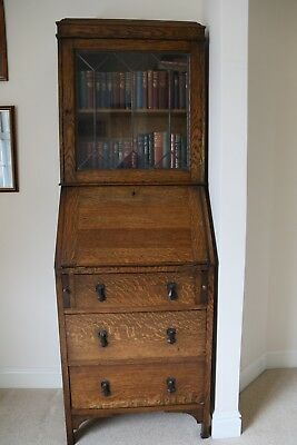 Writing desk/display bureau in mid oak, leaded glass and carrved wood detailing