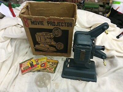 8mm battery operated projector with box and 3 films