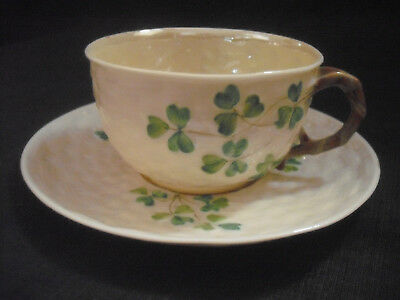 Irish Belleek Low Shamrock Tea Cup and Saucer Second Black Mark Period .