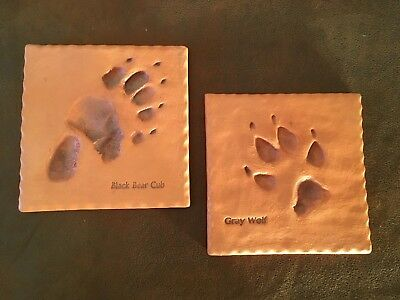 Set of 2 Ceramic trivets or wall hanging decor. Bear and Wolf foot prints
