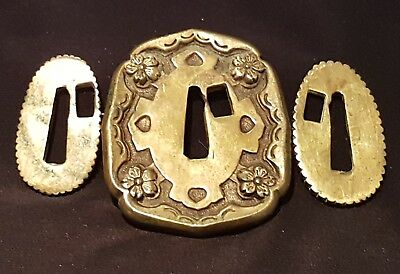 A stunning Edo period Kinko Brass Tsuba with Seppa. Decorated with Sakura Mon.
