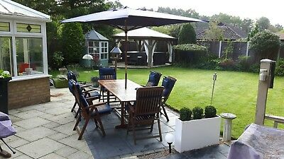 Teak, eight seat rectangular garden table and chairs complete with padded...