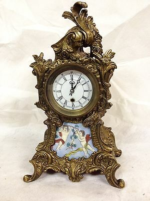 French style Bronze Clock with enamel face and windows.