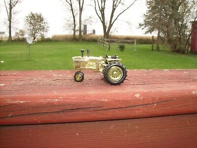 Collectible Earle John Deere tracter. 65fth anniversery edition. Gold plated.