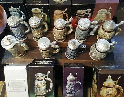 Avon Collectible ceramic Beer Steins lidded - set of 9. New in box. Mint