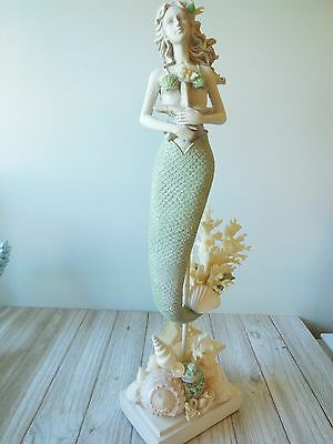 Mermaid On Shelled Stand
