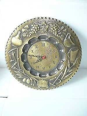 Wall clock in polished brass decorated 4 seasons quartz movement