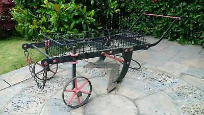 old wrought iron cart for flower display