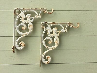 2 Vintage Cast Iron Brackets Architectural Salvage Angel blowing Trumpet (BC)