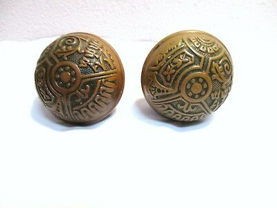 Antique Victorian Brass 2 Door Knobs Eastlake Ornate Set w center rod Patina