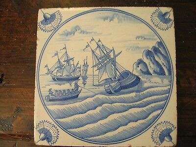 Antique delft tile harbour scene with shipping