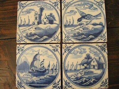 Four Antique delft tile blue and white bird, boat, buildings eighteenth century