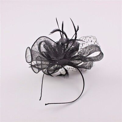 Black Fascinator with Net Bow Loop, Feather Tendrils & Fish Net Face Veil
