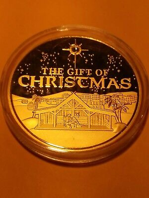 The gift of Christmas the birth of Christ gold layered coin with Crystal star