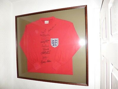 Framed and Hand Signed by 10 England 1966 World Cup Winners football shirt with