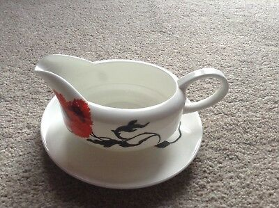 Wedgewood 'corn poppy gravy boat and stand designed by Susie Cooper