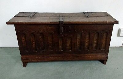 A Good Small Early 17th Century Carved Oak Plank Coffer With Original Ironwork
