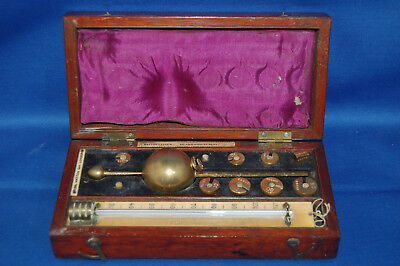 A boxed antique boxed Loftus and Buss hydrometer with full weights, less one