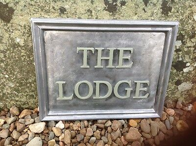"SOLID LEAD HOUSE NAME PLAQUE. "" THE LODGE "" painted letters"