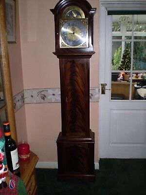 A great chiming solid mahogany grandfather clock by Smallcombe of Essex .