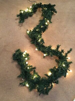"""christmas garland with little round white lights, really pretty table 96"""" length"""